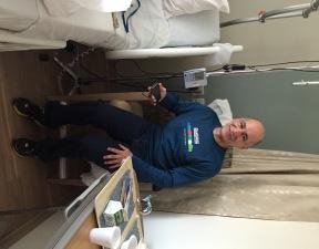 Leaving hospital with my marathon shirt.